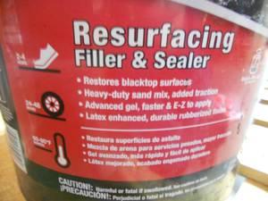 Bucket of Black Jack Resurfacing Filler and Sealer